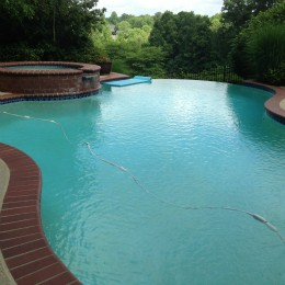 Crack repair and deck resurface made this backyard pool complete! - Suwannee, GA