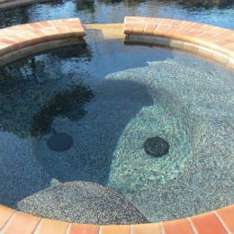 Midnight Blue Pebble surface and 'Autumn Leaves' coping -- Braselton, GA