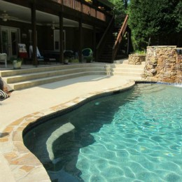 New concrete pool deck with new Textured surface - Marietta, GA